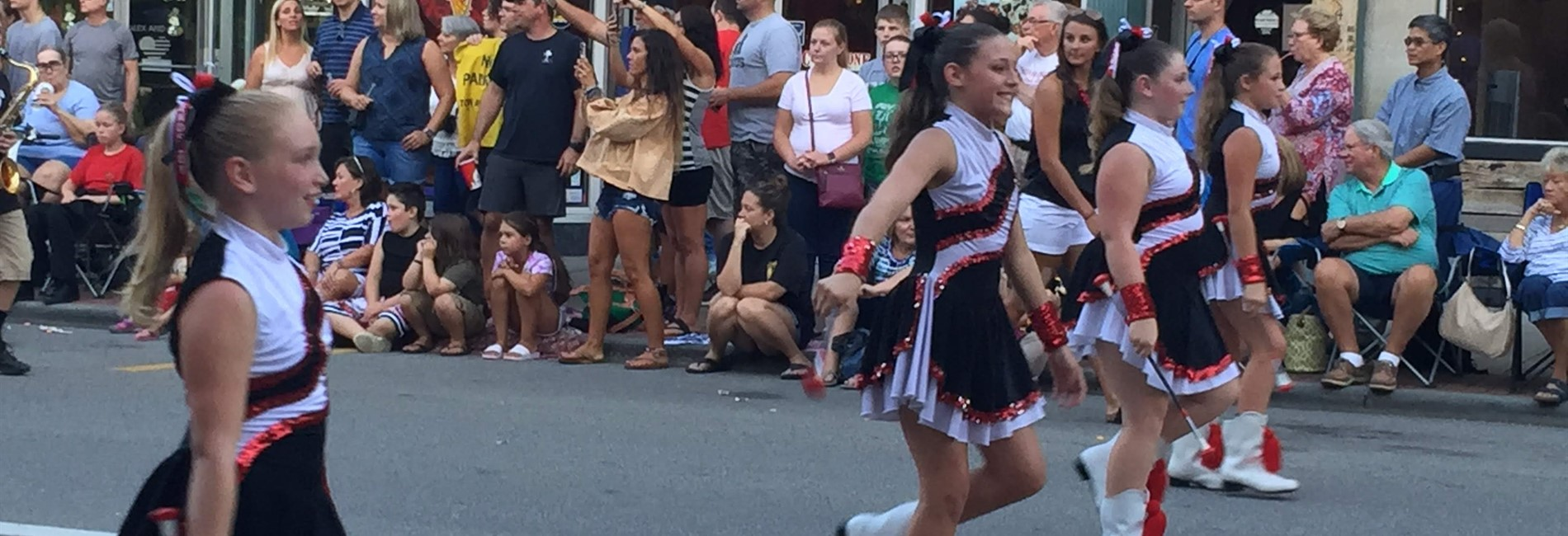 Westwood majorettes twirling in the Mon. County Fair Parade.